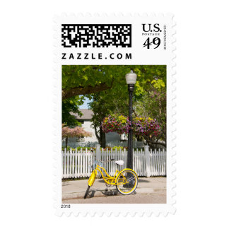 USA, Michigan, Mackinac Island. Yellow Bike Postage