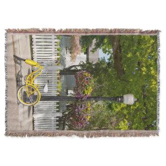 USA, Michigan, Mackinac Island. Yellow Bike Throw