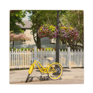 USA, Michigan, Mackinac Island. Yellow Bike Wooden Coaster