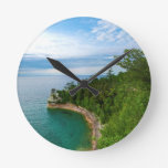 USA, Michigan. Miner's Castle Rock Formation 3 Round Clocks