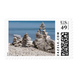 USA, Michigan. Stone Towers On The Beach Postage
