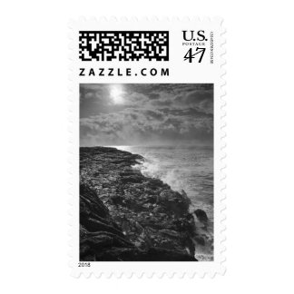USA. Molten lava flows into the ocean at sunrise Postage