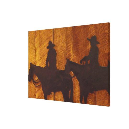 USA, Montana, Boulder River Cowboys on horses Canvas Print