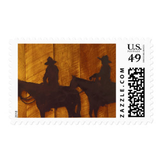 USA, Montana, Boulder River Cowboys on horses Postage