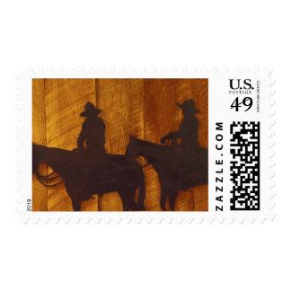 USA, Montana, Boulder River Cowboys on horses Postage