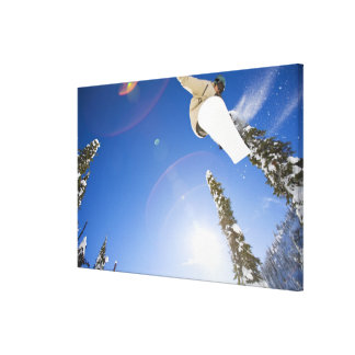 USA, Montana, Whitefish, Young man snowboarding Canvas Print