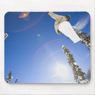 USA, Montana, Whitefish, Young man snowboarding Mouse Pad