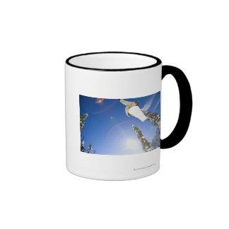USA, Montana, Whitefish, Young man snowboarding Ringer Mug