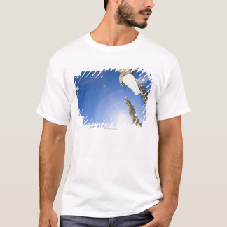 USA, Montana, Whitefish, Young man snowboarding T-Shirt