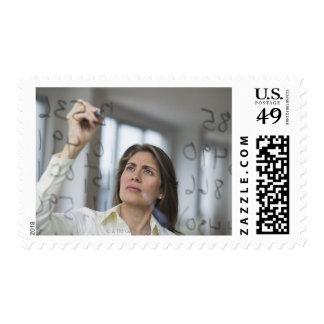 USA, New Jersey, Jersey City, Businesswoman Postage