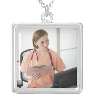 USA, New Jersey, Jersey City, female nurse Necklace