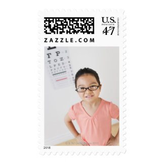 USA, New Jersey, Jersey City, Girl (6-7) at eye Postage