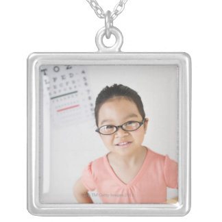 USA, New Jersey, Jersey City, Girl (6-7) at eye Silver Plated Necklace