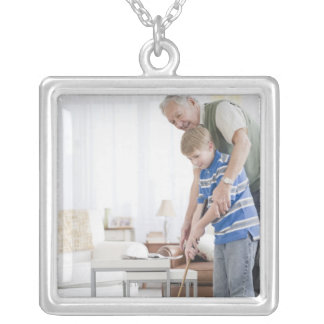 USA, New Jersey, Jersey City, grandfather and Silver Plated Necklace