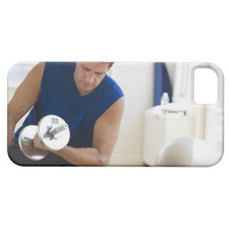 USA, New Jersey, Jersey City, Mature man lifting iPhone 5 Cases