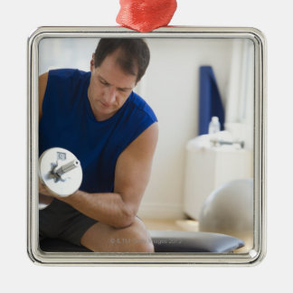 USA, New Jersey, Jersey City, Mature man lifting Square Metal Christmas Ornament