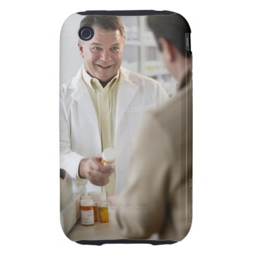 USA, New Jersey, Jersey City, Pharmacist selling Tough iPhone 3 Cases
