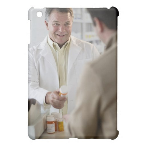 USA, New Jersey, Jersey City, Pharmacist selling iPad Mini Cover