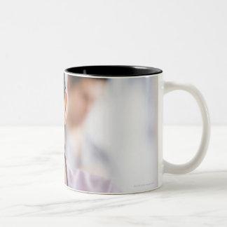 USA, New Jersey, Jersey City, Portrait of female Coffee Mugs