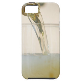 USA, New Jersey, Jersey City, pouring beer into iPhone 5 Covers