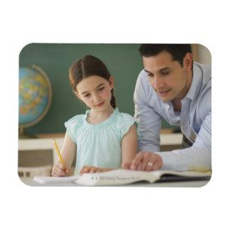 USA, New Jersey, Jersey City, teacher helping Magnet
