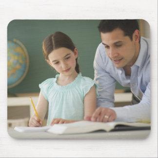 USA, New Jersey, Jersey City, teacher helping Mousepad