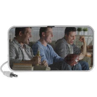 USA, New Jersey, Jersey City, three men watching 2 Laptop Speakers