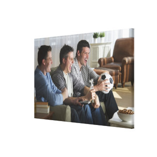 USA, New Jersey, Jersey City, three men watching Canvas Print