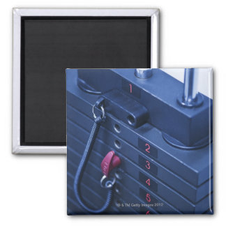 USA, New Jersey, Jersey City, Weights on 2 Inch Square Magnet