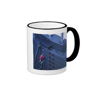 USA, New Jersey, Jersey City, Weights on Ringer Coffee Mug