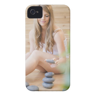 USA, New Jersey, Jersey City, Woman arranging iPhone 4 Case-Mate Case