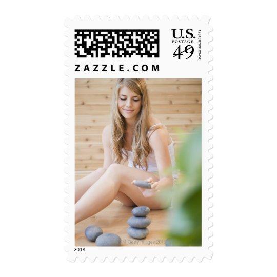 USA, New Jersey, Jersey City, Woman arranging Postage