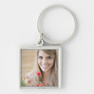 USA, New Jersey, Jersey City, Woman eating Keychain