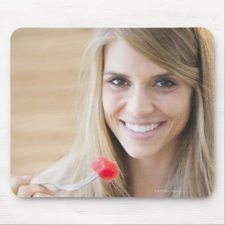 USA, New Jersey, Jersey City, Woman eating Mouse Pad