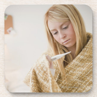 USA, New Jersey, Jersey City, woman wrapped in Beverage Coasters