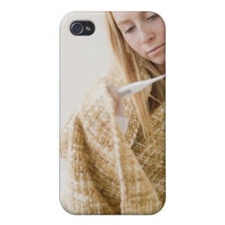 USA, New Jersey, Jersey City, woman wrapped in iPhone 4/4S Covers