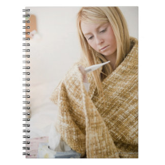USA, New Jersey, Jersey City, woman wrapped in Notebook