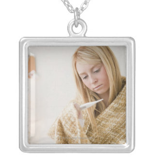 USA, New Jersey, Jersey City, woman wrapped in Square Pendant Necklace
