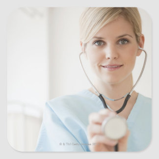 USA, New Jersey, Jersey City, Young nurse with Square Sticker