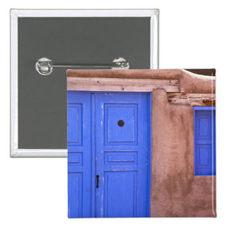 USA, New Mexico, Santa Fe. View of blue door and Buttons