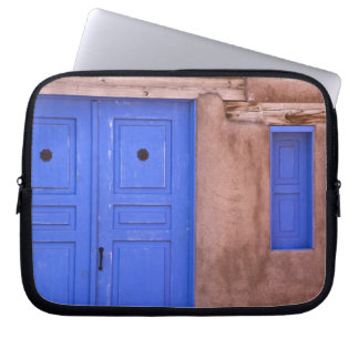USA, New Mexico, Santa Fe. View of blue door and Computer Sleeve