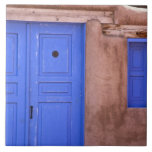 USA, New Mexico, Santa Fe. View of blue door and Large Square Tile