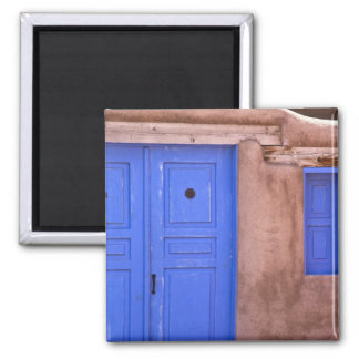 USA, New Mexico, Santa Fe. View of blue door and Refrigerator Magnets