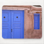 USA, New Mexico, Santa Fe. View of blue door and Mouse Pad