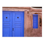 USA, New Mexico, Santa Fe. View of blue door and Postcard