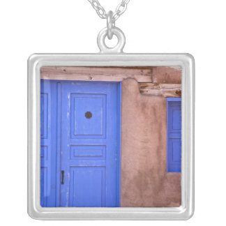 USA, New Mexico, Santa Fe. View of blue door and Silver Plated Necklace