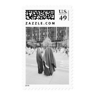USA, NEW YORK: New York City Nuns Watching NYC Postage Stamp