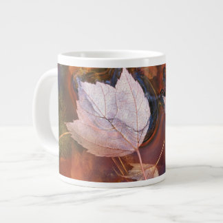 USA, Northeast, Fall leaves in puddle with Large Coffee Mug