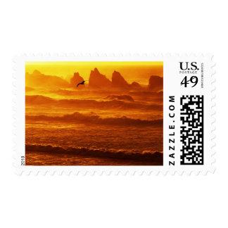 USA, Oregon, Bandon. Sunset over waves and sea Postage Stamp