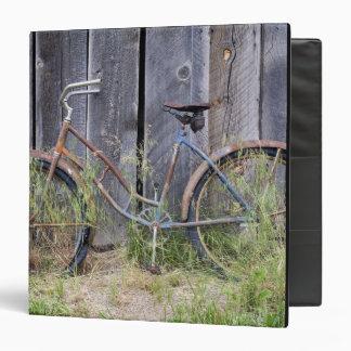 USA, Oregon, Bend. A dilapidated old bike 3 Ring Binders